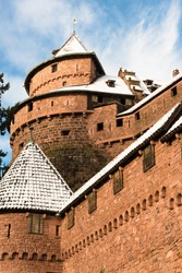 Tower of the Haut-Koenigsbourg castle under the snow in winter, Alsace, France