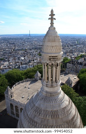 Tower of the Sacre Coeur with the Eiffel Tower in the background