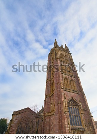 Tower of the St Mary Magdalene parish church in Taunton, Somerset, England, with a blue and cloudy sky