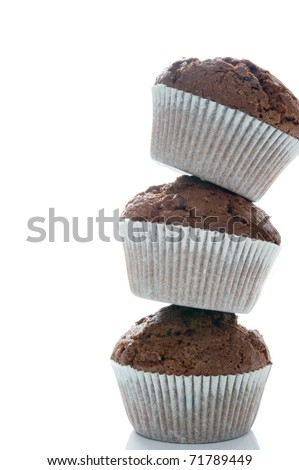 Tower of three chocolate muffins on a white background