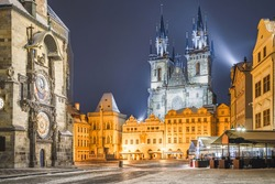 Tower Of Town Hall With Astronomical Clock - Orloj and Tyn Church on Old Town Square In Prague, the Czech Republic. Winter night without tourist.