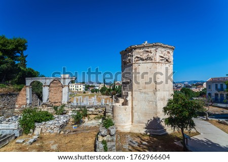 Tower of Winds or Aerides on Roman Agora, Athens, Greece. It is a tourist attraction of Athens. Panorama of Ancient Greek ruins in the Athens center at Plaka district. Scenic postcard of old Athens.