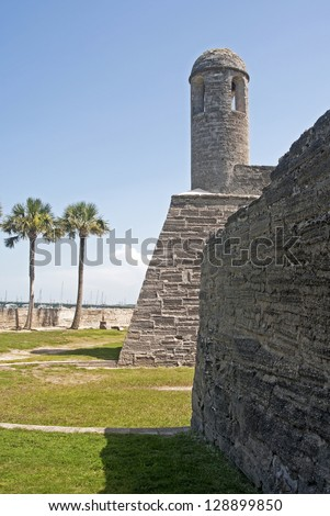 Tower, walls and field of the old Castillo de San Marcos, in St. Augustine, Florida, on a sunny and overcast day.