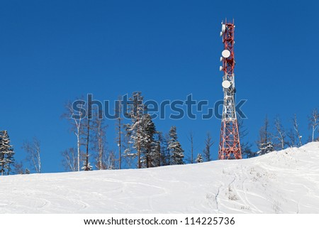 Tower with antennas connection in the mountains against the blue sky