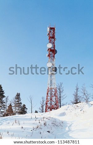 Tower with antennas of cellular communication on the background of blue sky