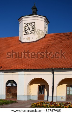 Tower with clock of town hall in Staszow, Poland - stock photo
