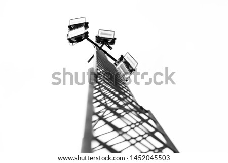 tower with five floodlights to the sports arena   #1452045503