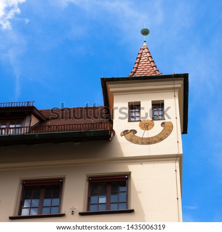 Tower with sundial looking like a cute smile