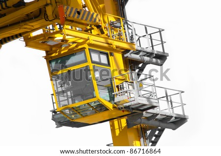 Tower yellow industrial crane cab on white