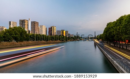 Towers and skyscrapers in Paris, France, used as office buildings as well as office buildings, by the water in front of barges on the river Seine in Quai de Grenelle, Front-de-Seine District. Paris Stock photo ©