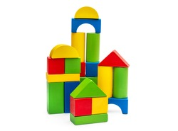 Towers from colorful wooden toy bricks on white.