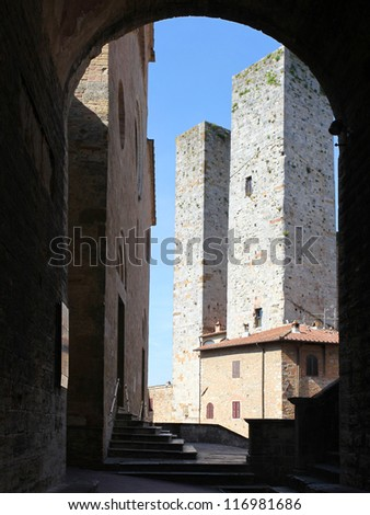 Towers in the piazza Duomo of the walled medieval town San Gimignano, Siena, Tuscany