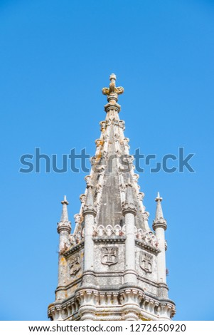 Towers of Jeronimos Monastery in Belem, Lisbon, Portugal during sunny day with blue sky