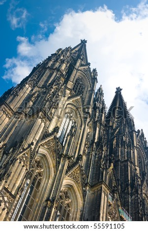 Towers of Koelner Dom (Cologne Cathedral) over blue sky in Koelne (Cologne)