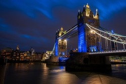 Towers of London, historical bridge of England illuminated in evening lights in London - UK
