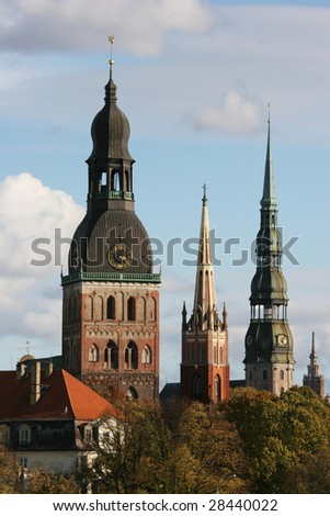 Towers of Old Town (Riga, Latvia) in autumn. View from Daugava river