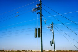 Towers of the electrified catenaries of a high-speed train in Spain.