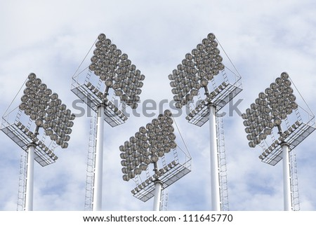 towers with spotlights and floodlights to illuminate the night games at the stadium