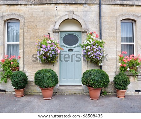 Town House Exterior Surrounded by Flowers and Plants