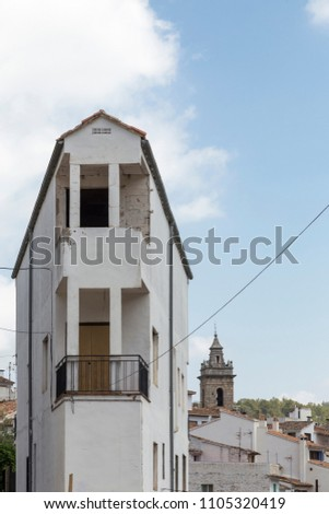 town house in the corner, in the background the church tower, Ain, Castellon, Spain