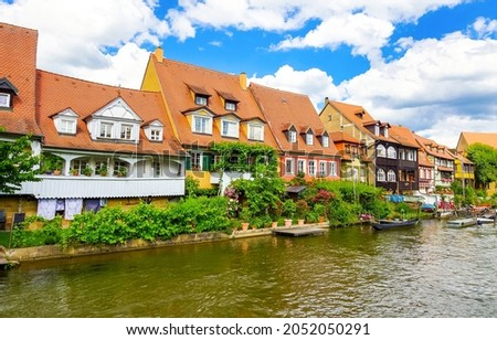Town houses on river canal. River canal town houses. Canal in town