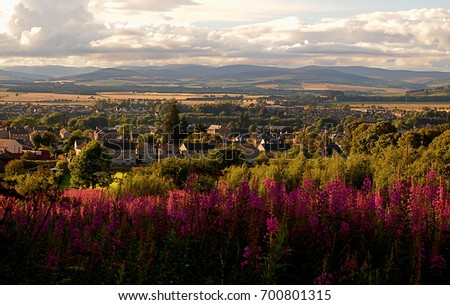 Town in the valley .. Forfar, Scotland - July 31, 2017 View from the hill to the picturesque landscape above the town of Forfar in Scotland.  Stock photo ©