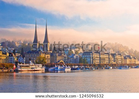 Photo of  Town of Luzern morning fog view from lake, central Switzerland
