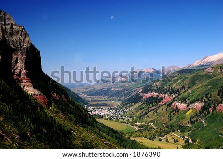 town of telluride and valley floor from east end of the box canyon looking west with moon setting