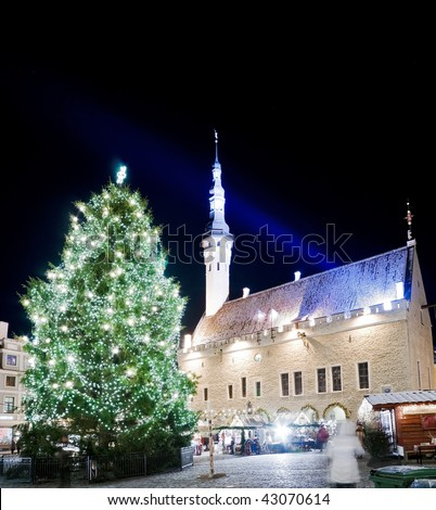 Town square view with town hall and decorated fir tree shortly before Christmas