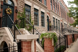Townhome apartments entrance by sidewalk in Chicago