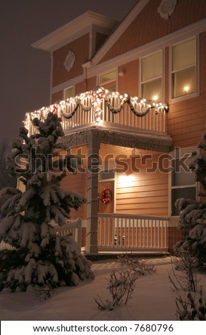Townhouse decorated with lights and lots of snow