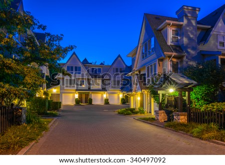 Townhouses, homes, community at  dusk, night time in suburbs of Vancouver, Canada.