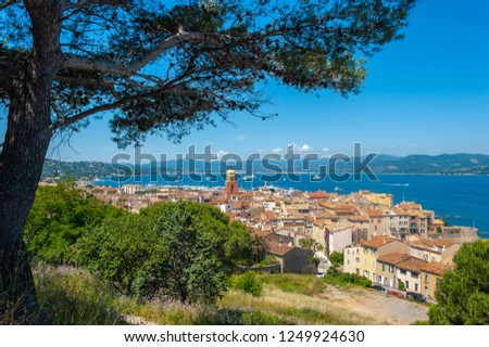 Townscape with the bell tower of Notre Dame de l'Assomption Church in Saint-Tropez in the Department Var of the province Provence-Alpes-Cote d Azur