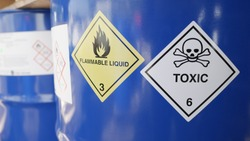 Toxic and flammable label on barrels in outdoor storage yard