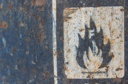 Toxic and flammable label on barrels in outdoor storage yard. Transportation of flammable and combustible liquids.
