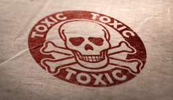 Toxic substances symbol over cardboard background. Composite image between a carboard photography and an illustration.
