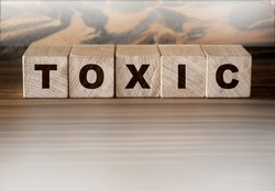 Toxic Word written on wooden cubes. Addiction concept. Healthcare medicine