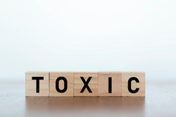 Toxic Word written on wooden cubes. Toxic is 2018 word of the year,