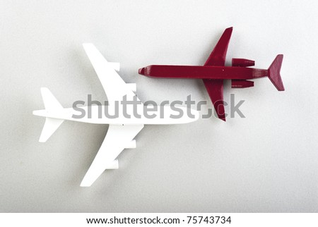 toy airplane in red color and white color