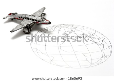 Toy Airplane on line drawing of the world.  Shallow depth of field from use of macro lens - stock photo