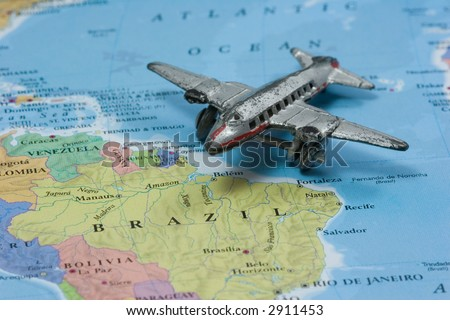Toy Airplane on Map of Brazil and South America.  Shallow depth of field from use of macro lens