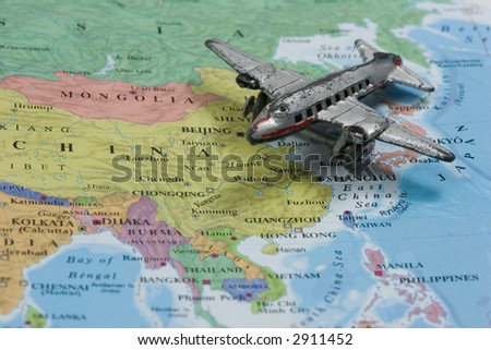 Toy Airplane on Map of China.  Shallow depth of field from use of macro lens
