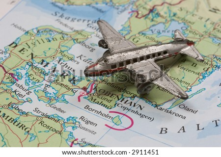 Toy Airplane on Map of Denmark.  Shallow depth of field from use of macro lens