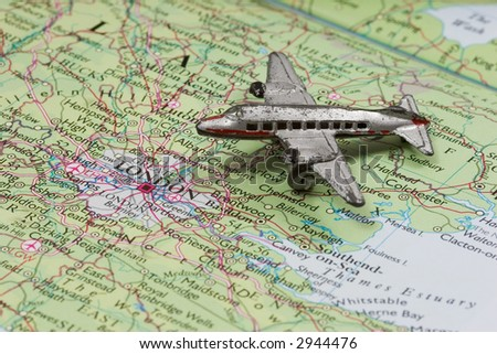 Toy Airplane on map of England.  Shallow depth of field from use of macro lens