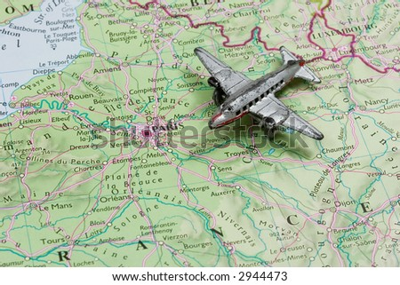 Toy Airplane on map of France.  Shallow depth of field from use of macro lens