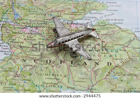 Toy Airplane on map of Scotland.  Shallow depth of field from use of macro lens