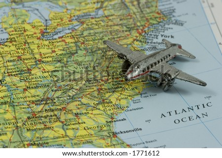 Toy Airplane on Map of Southeastern USA.  Shallow depth of field from use of macro lens.