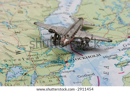 Toy Airplane on Map of Stockholm and Sweden.  Shallow depth of field from use of macro lens