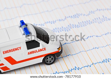 Toy ambulance car on ecg - medical background