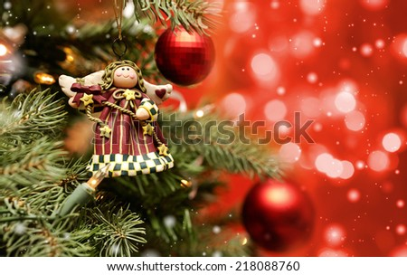 Toy angel hanging on the Christmas tree
